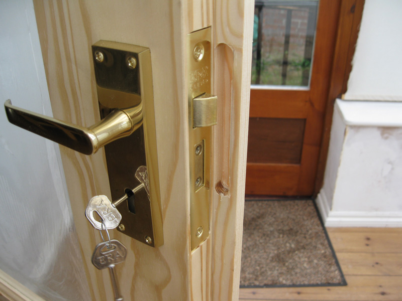 Lock fitting on wood door & Changing Your Internal or External Doors | Carpentry Services ... Pezcame.Com