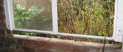 window frame before repairs