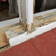 rotten wood frame being repaired