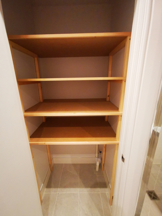 Utility cupboard storage by Southampton Carpentry